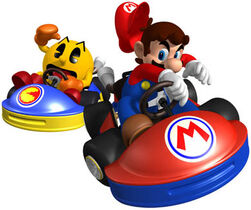 Mario vs. Pac-man in Mario Kart GP.