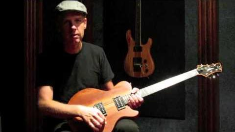 Tom_Dumont_with_his_Zora_guitar_(prototype_3)_at_GJ2_Guitars,_made_by_Grover_Jackson