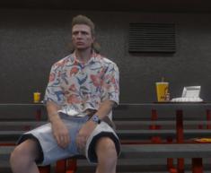 Jean-Pierre sitting in Jail Cafeteria