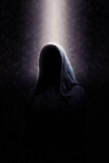 38437454-eerie-image-of-creepy-dimly-lit-faceless-cloaked-figure-in-spotlight-on-dark-background.jpg