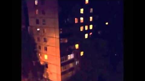 Slenderman? Stick creature cliimbs building in Russia