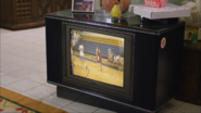 Burly Bears basketball game playing on TV S1E2a