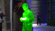 Glowing Security agent walking through the bullpen S1E2a