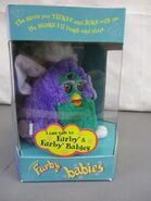 Purplegreenfurbybabyside