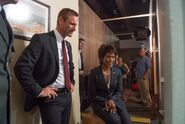 OHF- Aaron Eckhart and Angela Bassett rest on-set between takes