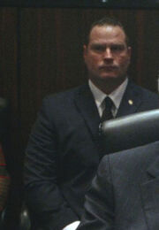 OHF- SS agent guarding Speaker of the House (played by extra Michael Byrnes).jpg