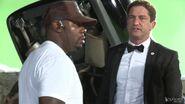 OHF- Director Antoine Fuqua looking over car crash stunt with Gerard Butler 1376340162954 525 21yfteoiSYbf1 0 0