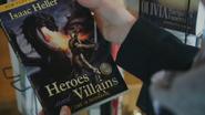 4x21 Henry Mills présentoir livres roman Heroes and Villains première de couverture