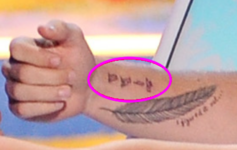 Liam-mysterious-arm-tattoo