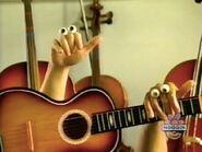 Oobi-shorts-Guitar-playing