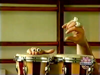 Oobi-shorts-Bongo-Drums-trying-to-play