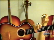 Oobi-shorts-Guitar-Oobi-tries