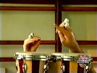 Oobi-shorts-Bongo-Drums-Grampu-pointing