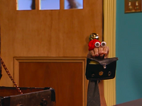 Oobi-Grown-Up-Kako-with-a-briefcase
