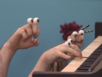 Oobi-Piano-Lesson-Oobi-playing