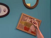 Oobi-Make-Art-hanging-a-painting