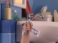 Oobi-Grampu-Day-Uma-holding-toothpaste