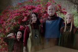 The young Alara as seen in a photo with her parents and older sister.