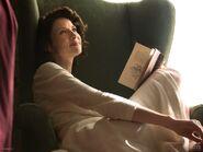 Claire-reading-20th-century-still