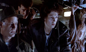 Ripley and group observing the marines