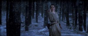 Rey grabs the lightsaber