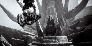 Daisy Ridley sitting on Palpatine Throne - behind the scenes
