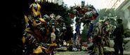800px-Movie Prime Jazz Ironhide Ratchet battleaftermath
