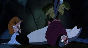Thumbelina removes the thorn from his wing