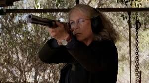 Laurie using a shotgun