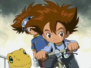 Tai teaches Younger Tai to ride a bike.