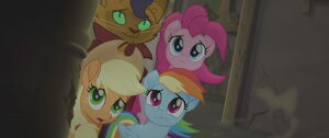 Pinkie Pie, Applejack, Rainbow Dash and Capper looking at the powerful tornado storm