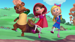 Goldie Red and Bear dancing.png