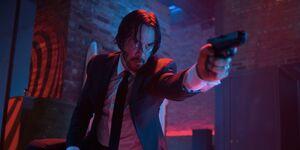 John Wick using his gun to shoot