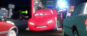 McQueen reluctantly leaves Radiator Springs to compete in the Cali Race