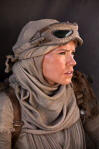 Rey wearing her scavenger gear