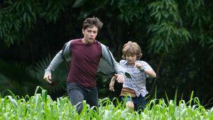 Zach and grey running from indomonious rex
