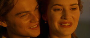 Jack Dawson and Rose Dewitt Bukater smiling kindly at each other