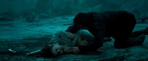 Ben holds Rey