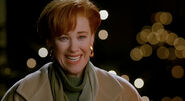 Kate McCallister smiling sweetly towards Kevin after finding him