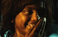 Latika as a little girl