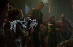 Star-Lord and Gamora breaking up a bar fight between Groot, Drax and Rocket