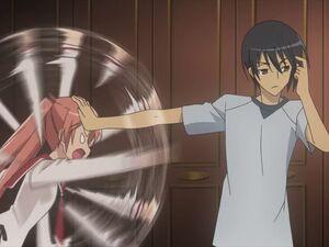 Kinji fending Aria off