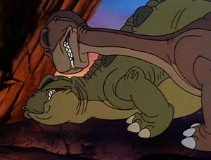 Littlefoot and Spike about to push a boulder onto Sharptooth