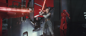 Rey with Kylo's lightsaber