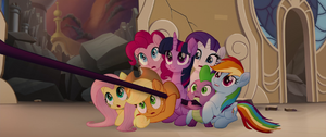 Twilight Smiling as her Friends look Shocked