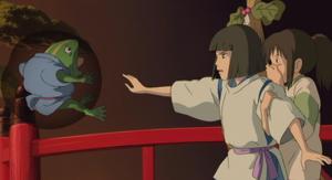 Haku stuns frog with Chihiro watching on