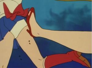 Sailor Mars kicks Sailor Moon