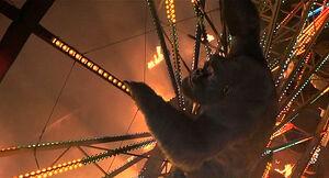 Joe climbs up the Ferris Wheel to save Jason
