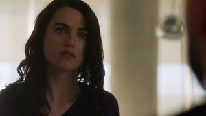 Lena while Lex explains their Crisis situation