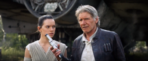 Han offers a blaster to Rey